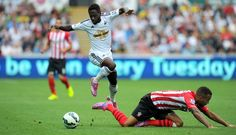 Southampton player Ryan Bertrand is beaten to the ball by Nathan Dyer in Soton's 1-0 win