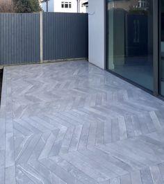 Grey chevron porcelain paving patio tile with picture frame border Terrace Tiles, Garden Tiles, Patio Tiles, Concrete Patio, Driveway Tiles, Patio Slabs, Back Garden Landscaping, Garden Paving, Outdoor Paving
