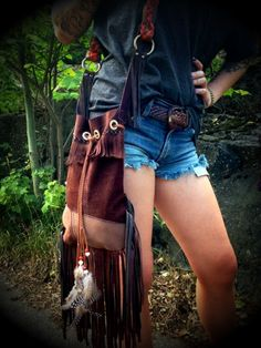 Hey, I found this really awesome Etsy listing at http://www.etsy.com/listing/157003772/suedeleather-fringe-bag-with-feathers