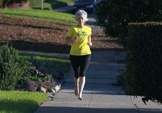 Hetherington runs shoeless through her neighborhood, a practice she says has improved her form. Photo: Paul Chinn, The Chronicle / SF
