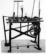01_FlachMotorStrickStoll One of the first motorized flat-bed knitting machines made by the company H. Stoll, Reutlingen, Germany, app. 1878.6
