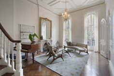 Exceptional wide, elevator Anglo-Italianate townhouse on Stuyvesant Square Park. The elegant building has a three bay facade, round-arched doors and windows, a lovely foliate patterned cast-iron balcony that runs the width of the edifice and Nyc Real Estate, Real Estate Sales, Luxury Real Estate, East 17, Data Room, Fireplaces For Sale, Iron Balcony, Arched Doors, Multi Family Homes