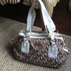 AUTHENTIC SIGNATURE& WHITE LEATHER STUDDED HANDBAG AUTHENTIC JACQUARD SIGNATURE STUDDED HANDBAG. Very Light wear on handles as shown, priced accordingly. PRICE IS FIRM!! Michael Kors Bags Satchels