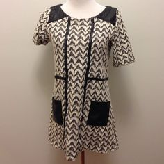 "Anthropologie B&W Mod Style Mini/Tunic Size M Cotton/poly blend with faux leather shoulders , pockets and seams. Amazing with leggings and boots. Super comfy textured fabric. 36"" bust 15"" shoulders 28"" back of neck to hem. Fits size S-M. Anthropologie Dresses Mini"