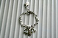 Baby charm bracelet by DakotaDesignsbyVicki on Etsy Baby Charm Bracelet, Adjustable Bracelet, Baby Gifts, Charmed, Pearls, Chain, Bracelets, Silver, Etsy