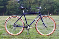 *SURLY* disk trucker complete bike  SPEC Frame: *SURLY* disc trucker BLUE LUG CUSTOM PAINT by COOK PAINT WORKS Headset:*VELO ORANGE* grand cru headset 1 1/8 (chrome) Wheels: *VELOCITY* P35 650B rim × *SHIMANO* deore XT hub Tire: *GRAND BOIS* hetre 650B tire (brown) Fender: *VELO ORANGE* smooth fender 650B Shifter: *SHIMANO* × *PAUL* thumbies RD: *SHIMANO* LX