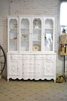 A beautiful French cabinet for your dining room or kitchen or bath!  FEATURES: Very sturdy solid wood construction with romantic French style.