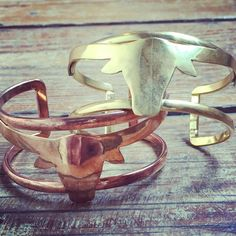 You'll want to hit up a rodeowith this Natalie B long horn cuff with amazing bull design! It's our favorite bracelet!by Natalie BBrassAdjustable1 1/4