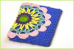 This crocheted iPad case is made in an elegant mandala design. It is much prettier than the typical industrial designed cases and has a personal touch. Fits the iPad 2 & other large iPads. It h…