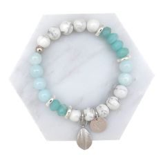 Created using beautiful marble howlite stone, amazonite gem, dyed jade and glass crystal beads with silver Greek spacers and a silver leaf charm.Length: XS - elasticised band will fit 15-17cm wrist All Cassie Louise designs are handmade with love in her home studio on the Mornington Peninsula and are adorned with our signature 'Cassie Louise' logo charm.