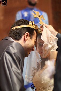 Armenian Orthodox Wedding what a great picture of the couple. The priest crowns the bride and groom and prays for them :)