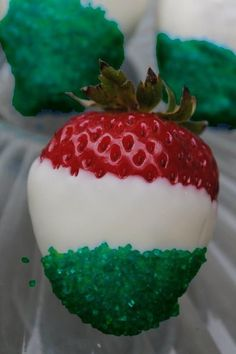 Strawberries dipped in white chocolate, then green sprinkles.