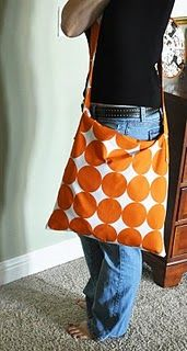 "diy messenger bag. need about 1 yard of decor fabric or other heavy fabric...she made this out of 3 16"" square coach pillow covers."