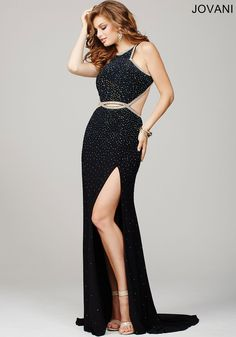 Stunning sleeveless floor length prom gown features an open back and sexy thigh high slit