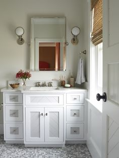 Phoebe Howard - white and grey bathroom with marble mosaic tile floor