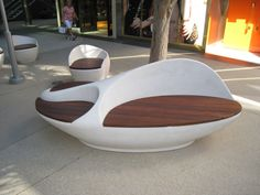 One of several large cast sculptural benches with ipe seating.  Versions also made with Chilewich cushioned seating.  Macerich's Santa Monica Place.  Fabricated by Penwal, www.Penwal.com.