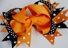 This sweet layered boutique bow measures approximately 4.5-5 wide and is expertly adhered to a partially lined double prong alligator clip.