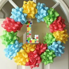 9 Party-Ready Birthday Wreaths You Can Make. would be cute for baby shower just change color of bows for gender,