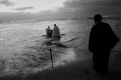 © A. Abbas/Magnum Photos // Cape Town. 1999. Every Sunday, at dawn, priests of a Zion Church, from the Khayelitsha black township, take their newly converted congregation to the sea to be baptised through immersion.