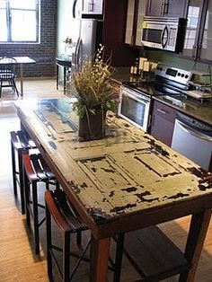 was old door - now kitchen island  Great idea for using these terrific old, and very historical old doors.  I have done this many times.  As a matter of fact my kitchen table is made of an old door and I have a coffee table made of and old door.  I love them!!