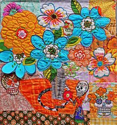 https://flic.kr/p/EfRnjv | Familiar | Dia de los Muertos is a familiar theme in my fiber art. I love the graphic boldness to the images and the bright colors and happy flowers. This little piece is collaged with raw edges and machine stitched. #cy365#captureyour365#familiar#diadelosmuertos#mystudiotoday