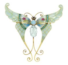 AN ART NOUVEAU ENAMEL AND MULTI-GEM BUTTERFLY, BY BOUCHERON. Designed as a butterfly, with a cushion-cut aquamarine and cabochon opal body, extending blue and green plique-á-jour enamel wings, enhanced by cabochon rubies and calibré-cut emeralds, accented by a collet-set diamond and gold wirework detail, mounted in gold, 1900, with maker's mark, with detachable brooch fitting of later addition. Elizabeth Taylor Collection.