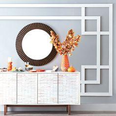 Geometric wood moulding frames a round mirror over a console table to create a unique accent wall. Interior Design Tips, Interior And Exterior, Wood Molding, Moulding Wall, Wood Wall Design, Build A Frame, Framed Wallpaper, Black And White Tiles, Stick On Tiles