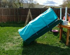 After picture of tunnel slide made out of hula hoops and outdoor fabric. Outdoor Fun For Kids, Backyard For Kids, Diy For Kids, Backyard Toys, Backyard Playhouse, Repurpose, Reuse, Sensory Garden, Playroom Storage