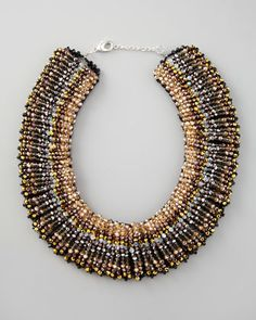 "Beaded Choker Necklace by Nakamol at Neiman Marcus. Perfect for filling scoop necklines, this Nakamol choker necklace is a dramatic piece. Iridescent, faceted beads. Black enamel-beaded backing. Lobster clasp with chain extender. 17-19""L. 2""W."