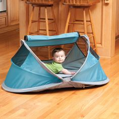 PeaPod, folds up the size of a sun visor, weight about 5 lbs. Perfect for traveling.