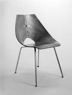 Designer: Ray Komai, American, born 1918  Manufacturer: J.G. Furniture Co., Inc.  Medium: Molded walnut plywood, chromed metal, rubber  Place Manufactured: Brooklyn, New York, USA  Dates: ca. 1949