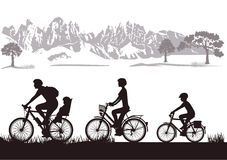 Family biking in countryside