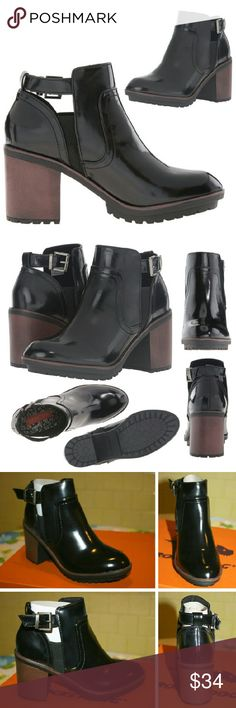 """Patent Platform Ankle Bootie w/ Side Cutouts NWT These 90's inspired, patent leather ankle booties add an edgy touch to any look with a rugged lug sole and chunky block heel.They feature straps with adjustable buckles, elastic side panels for a stretch fit, and fashionable side cutouts! The faux patent leather material is 100% polyurethane. The lug sole is rubber. The material flexes which adds comfort. The shaft measures approx. 4.5"""" (from arch), the heel is about 2.75"""", and the platform is…"""
