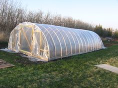 Instructions for building a Hoop House  http://www.albertahomegardening.com/how-to-build-an-inexpensive-hoop-style-greenhouse/