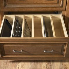A tall drawer for pans! They stand up so you don't have to dig to find the one you want.