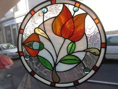 Stained Glass Art Nouveau floral Cheerful, bright and fun.I think it's pretty perfect. The flower could be redder if you prefer. Stained Glass Light, Stained Glass Flowers, Stained Glass Suncatchers, Stained Glass Designs, Stained Glass Panels, Stained Glass Projects, Stained Glass Patterns, Leaded Glass, Mosaic Glass