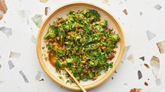 Broccoli Spoon Salad With Warm Vinaigrette Recipe   Bon Appetit Moroccan Spice Blend, Moroccan Spices, Raw Broccoli, Broccoli Salad, Broccoli Dishes, Brocolli, Broccoli Recipes, Pitted Dates Recipe, Raw Pistachios