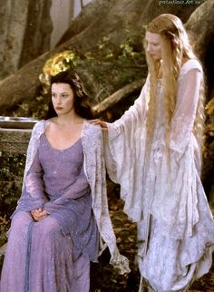 Galadriel's daughter Celebrian married Elrond. So Galadriel is Arwen's grandmother. And it makes me wonder what they're looking at... Galadriel is following Arwen's gaze towards something.