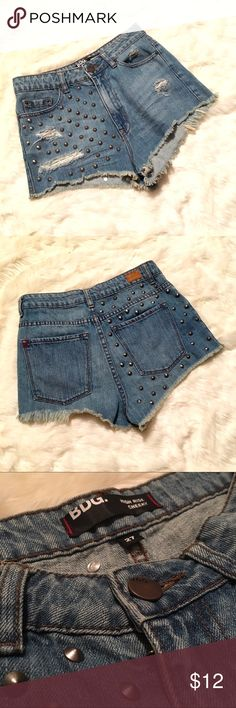 BDG High Rise Cheeky Studded Denim Shorts Summer is over but it's never too early to stock up on shorts. These BDG shorts are cute and have a 1.75 inch distressed inseam. Great condition. Bundle for a discount! Custom bundles on request :) Let me know if you have questions BDG Shorts Jean Shorts