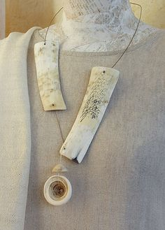 AMALTHEE CREATIONS  Zebu horn necklace with ancient conus shell and manuscript paper