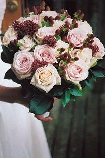 Combine pink roses with berries and foliage for a classic bouquet. (BridesMagazine.co.uk)