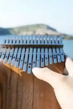 Now you can play the piano even if you don't know how to read music! The Kalimba thumb piano (an African musical instrument) is one instrument that anyone can easily learn to play at any age. Cool Music Videos, Music Video Song, Good Music, Music Chords, Acoustic Music, Music Mood, Mood Songs, Dream Music, Music Is Life