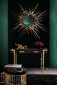 The vintage-inspired drama of this elegant console captures the essence of Haute style. Sensuous curves and subtle gold gilt makes the Orchidea an irresistible choice. Oval top in ebony veneer, structure in high gloss black lacquer with two drawers lined in black velvet and adorned with cast bronze orchid handles supported by a polished brass base.