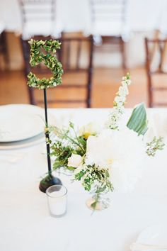 "This topiary table number ""sprouts"" from the table in a romantically modern way, bringing with it garden delight.Related: 50 Memorable Ideas for Your Table Numbers"