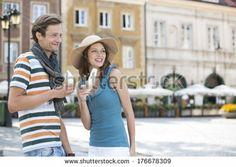 Tourist couple enjoying ice cream cones during vacation - stock photo