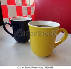 2 mugs of coffee on the table at the diner.