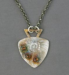 Fine silver (PMC) pendant with bezel-set dark citrines; jewelry by Mirinda Kossoff