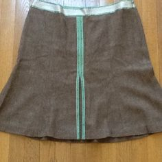 Ann Taylor Loft skirt size 12P 12 petite . Wool and rayon. Fully lined. Photo 3 shows small hole at bottom of skirt. Silk trim with beads. 21 in long 35 in waist. Ann Taylor Loft Skirts