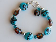 Coastal inspired turquoise and amber lampwork bead bracelet.  Love this.