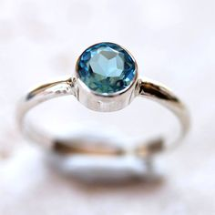 So pretty :)  Swiss Blue Topaz Ring Faceted Aqua Blue Gemstone by TheSlyFox, $76.00